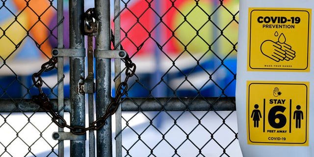 A gate is locked at the closed Ranchito Elementary School in the San Fernando Valley section of Los Angeles.