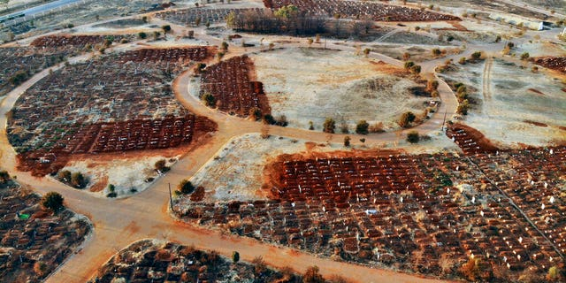 Recently filled graves are seen in the Olifantsveil Cemetery outside Johannesburg, South Africa, Wednesday Aug. 5, 2020. The frequency of burials in South Africa has significantly increased during the coronavirus pandemic, as the country became one of the top five worst-hit nation. New infection numbers around the world are a reminder that a return to normal life is still far from sight.