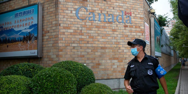 Metis Entrepreneur - A security officer wearing a face mask to protect against the coronavirus stands outside the Canadian Embassy in Beijing, Thursday, Aug. 6, 2020. China announced on Friday that it had sentenced a Canadian to death on drug charges, the second day in a row Chinese courts handed down the death penalty to a Canadian citizen. (AP Photo/Mark Schiefelbein)