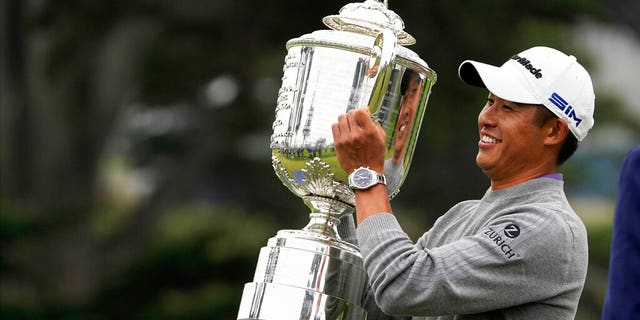Collin Morikawa holds the Wanamaker Trophy after winning the PGA Championship golf tournament at TPC Harding Park Sunday, Aug. 9, 2020, in San Francisco.