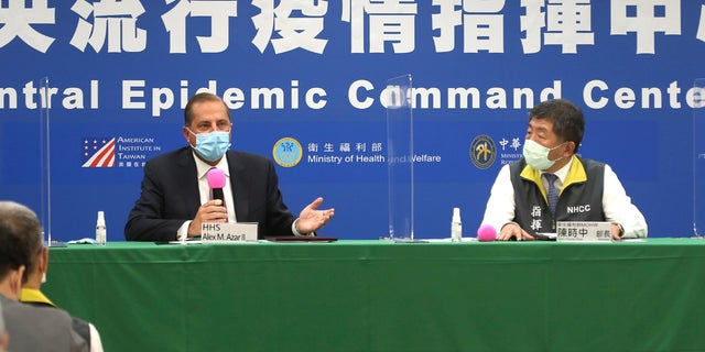 Azar, left, and Taiwanese Minister of Health and Welfare Chen Shih-chung answer questions from media at the Central Epidemic Command Center in Taipei, Taiwan, Monday, Aug. 10, 2020. (AP Photo/Chiang Ying-ying)