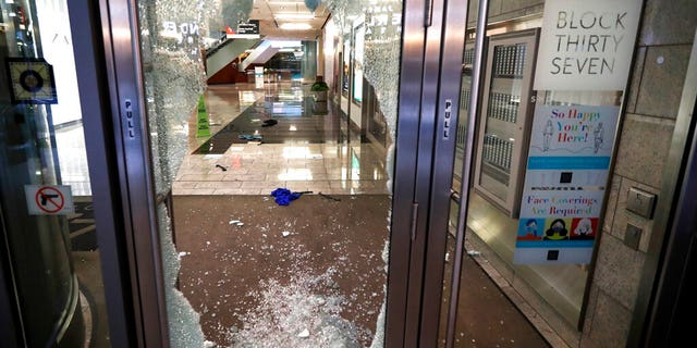 A door to the Block 37 retail building is shattered Monday, Aug. 10, 2020, after vandals struck overnight in Chicago's famed Loop.