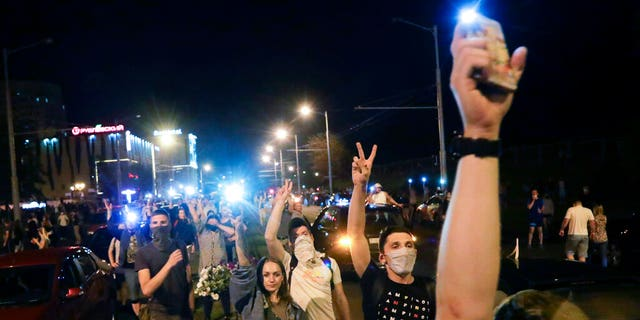 People gather during a mass protest following presidential elections in Minsk, Belarus, Monday, Aug. 10, 2020.