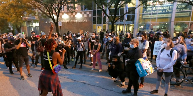 Ariel Atkins, a lead organizer for Black Lives Matter Chicago, leading a protest Monday outside the Chicago Police Department's District 1 station.