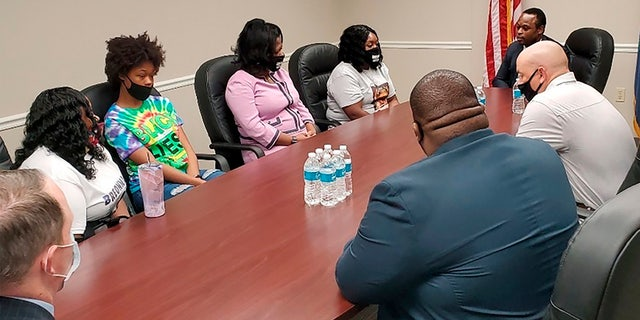 Tamika Palmer, far left, the mother of Breonna Taylor, and other family members meet with Kentucky Attorney General Daniel Cameron on Wednesday, Aug. 12, 2020, in Louisville, Ky. (Christopher 2X via AP)