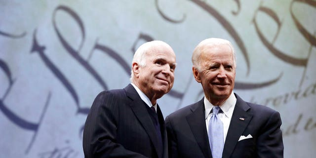 Sen. John McCain, R-Ariz., receives the Liberty Medal from Chair of the National Constitution Center's Board of Trustees, former Vice President Joe Biden, in Philadelphia.