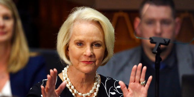 Cindy McCain waves to the crowd after being acknowledged by Arizona Republican Gov. Doug Ducey during his State of the State address.