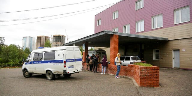 An ambulance is parked outside the hospital intensive care unit where Alexei Navalny is hospitalized in Omsk, Russia, Thursday, Aug. 20, 2020.