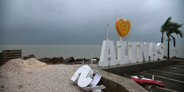 Remnants of a city sign lay on the beach damaged by Tropical Storm Laura in Salinas, Puerto Rico, Saturday, Aug. 22, 2020. (Associated Press)