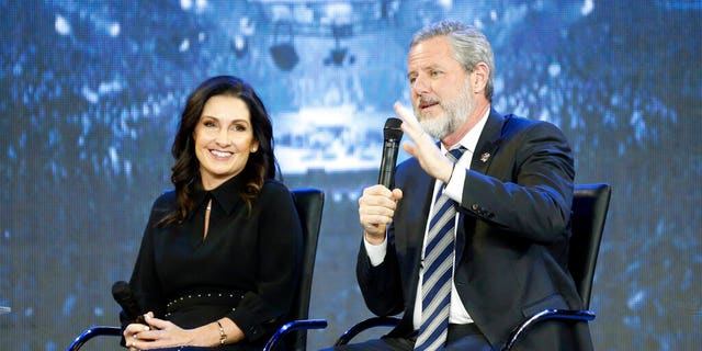 This Wednesday Nov. 28, 2018 file photo shows Rev. Jerry Falwell Jr., right, and his wife, Becki during after a town hall at a convocation at Liberty University in Lynchburg, Va. (AP Photo/Steve Helber)