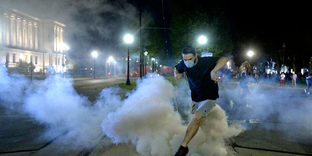 Wisconsin Gov. Tony Evers has summoned the National Guard to head off another round of violent protests after the police shooting of a Black man under murky circumstances turned Kenosha into the nation's latest flashpoint city in a summer of racial unrest (Sean Krajacic/Kenosha News via AP)