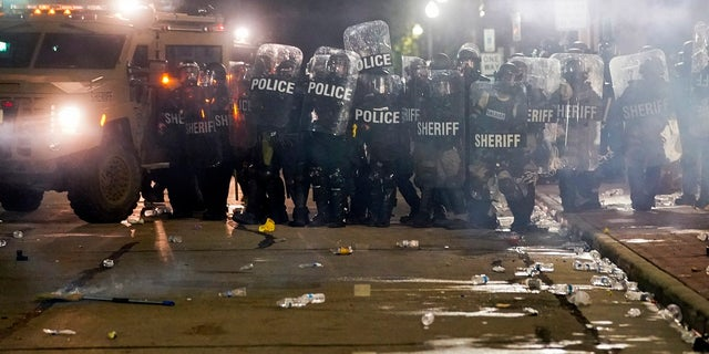 Police clash with protesters near the Kenosha County Courthouse on Monday. (AP Photo/Morry Gash)