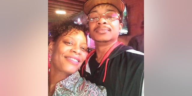 In this September 2019 selfie photo taken in Evanston, Ill., Adria-Joi Watkins poses with her second cousin Jacob Blake. He is recovering from being shot multiple times by Kenosha police last weekend. His lawyer said Friday that he was no longer restrained in his hospital bed. (Courtesy Adria-Joi Watkins via AP)