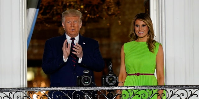 President Donald Trump and first lady Melania Trump arrive on South Lawn of the White House on the fourth day of the Republican National Convention, Thursday, Aug. 27, 2020. (AP Photo/Evan Vucci)