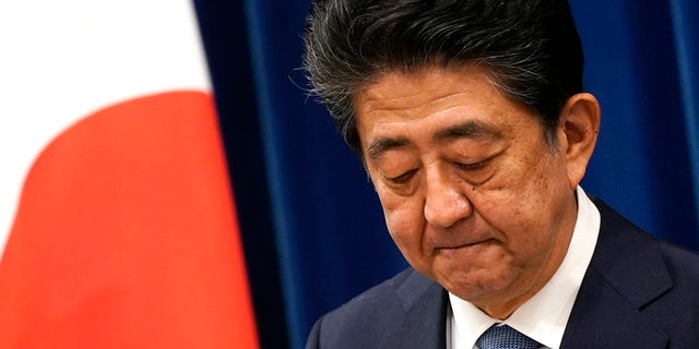 Japanese Prime Minister Shinzo Abe speaks during a press conference at the prime minister official residence in Tokyo Friday, Aug. 28, 2020. Abe, Japan's longest-serving prime minister, says he's resigning because a chronic illness has resurfaced. (Franck Robichon/Pool Photo via AP)