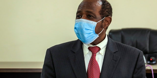 """Paul Rusesabagina, who was portrayed in the film """"Hotel Rwanda"""" as a hero who saved the lives of more than 1,200 people from the country's 1994 genocide, and is a well-known critic of President Paul Kagame, has been arrested by the Rwandan government on terror charges, police announced on Monday, Aug. 31, 2020. (AP Photo)"""