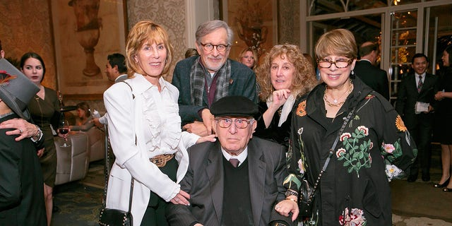 Arnold Spielberg is surrounded by his children, Nancy Spielberg, Steven Spielberg, Anne Spielberg and Sue Spielberg, at the celebration of his 100th birthday in 2017.