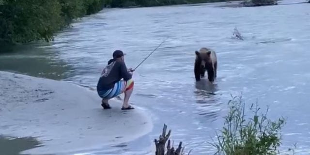 """""""Caught a sockeye and a bear!"""" the fisherman joked on Facebook."""