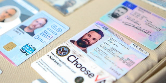 This photo released by the Venezuelan Miraflores presidential press office shows what Venezuelan authorities identify as the I.D. cards of former U.S. special forces citizen Airan Berry, right, and Luke Denman, left, in Caracas, Venezuela.