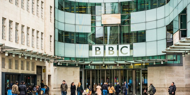 London, UK - People outside the main entrance to the BBC Broadcasting House in central London.