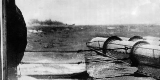 A view of the German battleship Bismarck as it was sinking, torpedoed by a British ship off Brest.