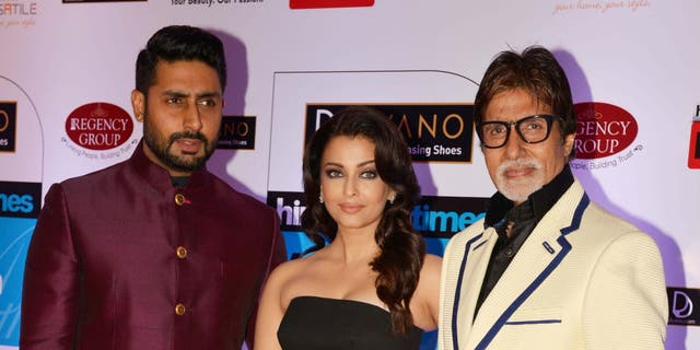 Left to right: Abhishek Bachchan, Aishwarya Rai Bachchan and Amitabh Bachchan at HT Mumbais most stylish awards 2015 in Mumbai. (Photo by Milind Shelte/The India Today Group via Getty Images)
