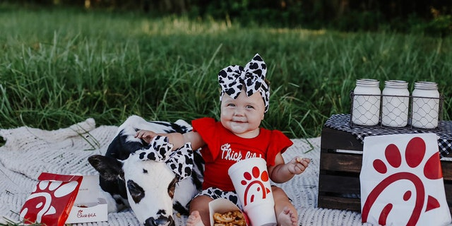 Chick-fil-A-themed photoshoot features a rescue calf and a baby having an adorable picnic. (Tori Walker Photography LLC)