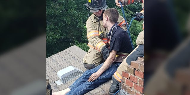 The Evansville Fire Department took apart the chimney to free Cody Methanial Sargent, 29.