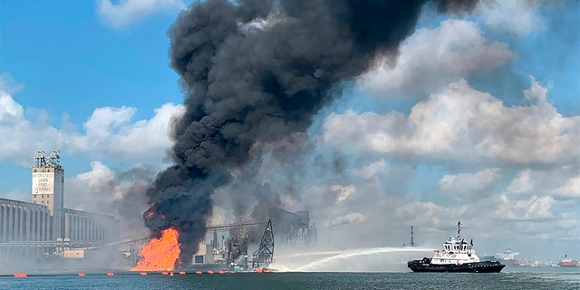 In this photo released by the U.S. Coast Guard, Coast Guard crews respond to a fire dredger in the ship channel of the Port of Corpus Christi on August 21 in Corpus Christi, Texas (U.S. Coast Guard via AP).