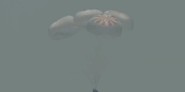 In this frame grab from NASA TV, the SpaceX capsule splashes down Sunday, Aug. 2, 2020 in the Gulf of Mexico.