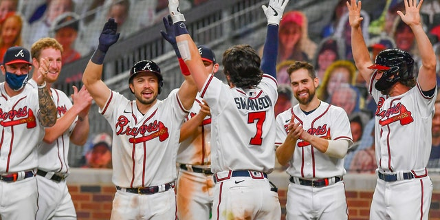The Atlanta Braves celebrating after shortstop Dansby Swanson (7) hit his walk-off two-run home run in the 9th inning.