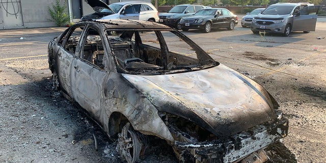 The damage in Kenosha includes many burned-out cars.