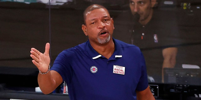 Los Angeles Clippers' head Coach Doc Rivers directs his team during the first half of an NBA basketball game against the Phoenix Suns' Tuesday, Aug. 4, 2020, in Lake Buena Vista, Fla. (Kevin C. Cox/Pool Photo via AP)