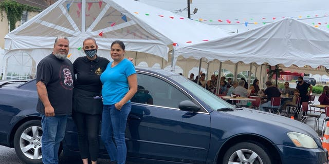 Lisa Mollet is a waitress at the Empire Diner in Brooklawn, N.J. and was shocked to recently receive quite the generous gratuity in the form of a car, pictured.