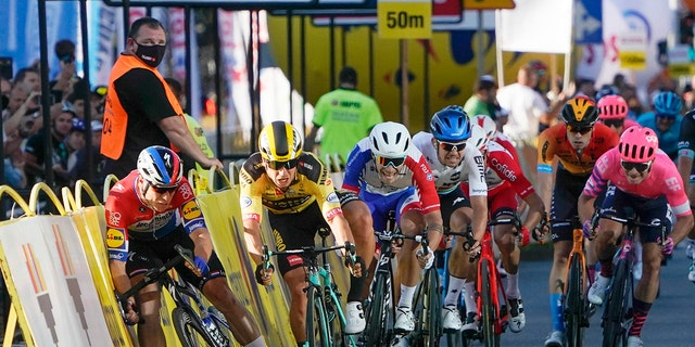 Sprinting for the win Dutch cyclist Fabio Jakobsen, left, hits side barriers at the start of a crash with his countryman Dylan Groenewegen, 2nd left, on the final stretch of the opening stage of the Tour de Pologne race in Katowice, Poland, on Wednesday, Aug. 5, 2020. (AP Photo/Tomasz Markowski)<br>