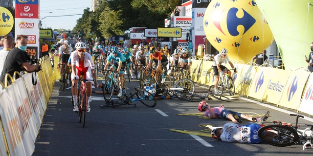 Cyclists are injured in a crash on the final stretch of the opening stage of the Tour de Pologne race in Katowice, Poland, on Wednesday, Aug. 5, 2020. (AP Photo)<br>