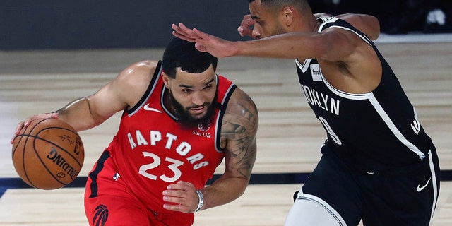 Toronto Raptors guard Fred VanVleet, left, drives against Brooklyn Nets guard Timothe Luwawu-Cabarrot, right, during the first half of Game 4 of an NBA basketball first-round playoff series, Sunday, Aug. 23, 2020, in Lake Buena Vista, Fla. (Kim Klement/Pool Photo via AP)