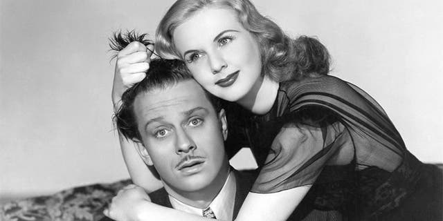 Actress Deanna Durbin and David Bruce in a scene from the movie 'Lady on a Train.'