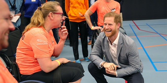 Prince Harry, Duke of Sussex speaks with athletes during a sports training session at Sportcampus Zuiderpark during a visit to The Hague as part of a program of events to mark the official launch of the Invictus Games.