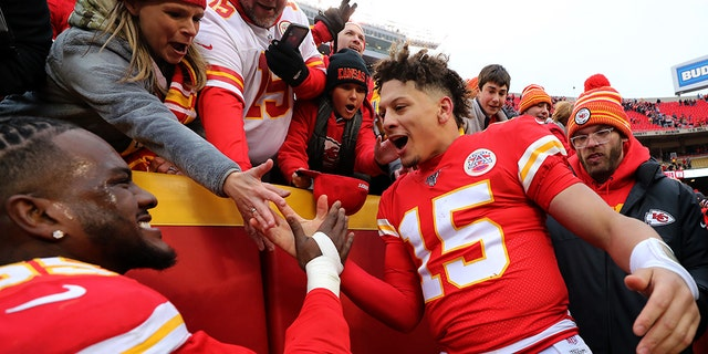 Quarterback Patrick Mahomes #15 and defensive end Frank Clark #55 of the Kansas City Chiefs celebrate with fans after the Chiefs defeated the Los Angeles Chargers 31-21 to win the game at Arrowhead Stadium on Dec. 29, 2019 in Kansas City, Missouri. (Photo by Jamie Squire/Getty Images)