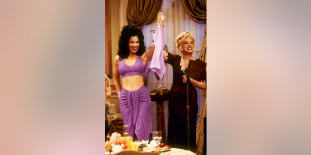 Bette Midler (right) guest stars with Fran Drescher in 'The Nanny.' (Photo by CBS via Getty Images)