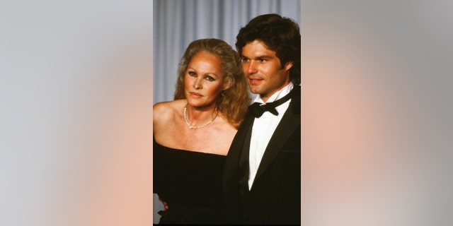 Actress Ursula Andress with actor Harry Hamlin poses backstage during the 54th Academy Awards at Dorothy Chandler Pavilion in Los Angeles, Calif.
