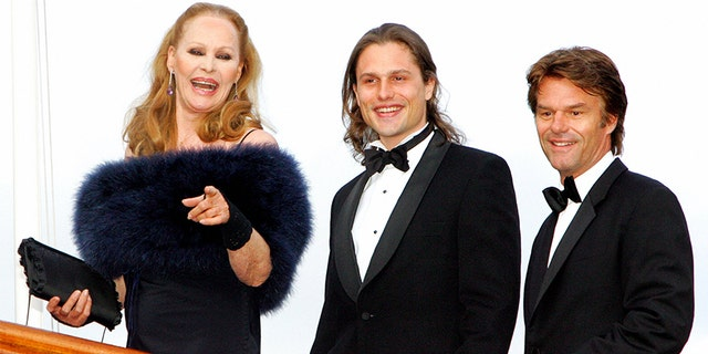 Swiss Hollywood film star Ursula Andress (L) arrives with her son Dimitri Hamlin (C) and former partner Harry Hamlin at The Royal Yacht Britannia in Edinburgh, Scotland, 18th May 2006, to take part in a special party to celebrate her 70th birthday. Andress was the original 'Bond girl' having become famous for her role as Honey Rider in the James Bond film, 'Dr. No.'