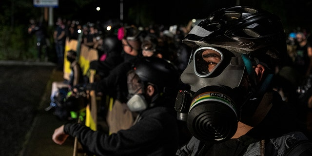 Protesters are seen during a standoff at a Portland police precinct in Portland, Oregon on August 15, 2020. (Photo by Paula Bronstein/Getty Images )