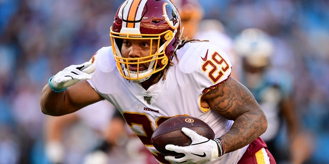 Derrius Guice was released by Washington after a domestic violence incident. (Photo by Jacob Kupferman/Getty Images)
