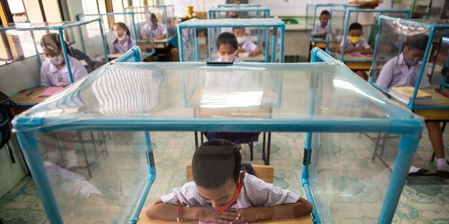 Plastic screens also have been set up around desks at the school. (Getty Images)