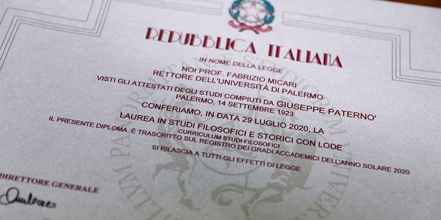"The graduation certificate of Giuseppe Paterno's, 96, Italy's oldest student, who completed his undergraduate degree in history and philosophy, is pictured at the University of Palermo, in Palermo, Italy, July 29, 2020. REUTERS/Guglielmo Mangiapane SEARCH ""ITALY'S OLDEST STUDENT"" FOR THIS STORY. SEARCH ""WIDER IMAGE"" FOR ALL STORIES. - RC294I9DDBSK"