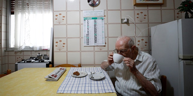 "Giuseppe Paterno, 96, Italy's oldest student, has breakfast in his kitchen, two days before he graduates from The University of Palermo with an undergraduate degree in history and philosophy, at his home in Palermo, Italy, July 27, 2020. REUTERS/Guglielmo Mangiapane SEARCH ""ITALY'S OLDEST STUDENT"" FOR THIS STORY. SEARCH ""WIDER IMAGE"" FOR ALL STORIES. - RC294I9K9JZI"