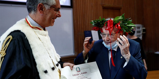 "Giuseppe Paterno, 96, Italy's oldest student, is awarded his graduation certificate after completing his undergraduate degree in history and philosophy, during his graduation at the University of Palermo, in Palermo, Italy, July 29, 2020. REUTERS/Guglielmo Mangiapane SEARCH ""ITALY'S OLDEST STUDENT"" FOR THIS STORY. SEARCH ""WIDER IMAGE"" FOR ALL STORIES. - RC294I9JPAHJ"