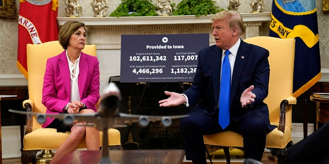 In this May 6, 2020 file photo, President Donald Trump speaks during a meeting with Gov. Kim Reynolds, R-Iowa, in the Oval Office of the White House in Washington.